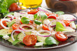 fresh greek salad with feta cheese on a plate, vertical