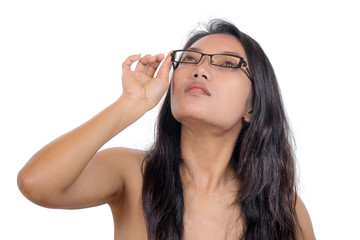 Young woman looking up through glasses