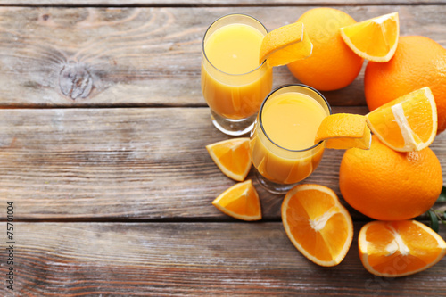 canvas print picture Freshly squeezed orange juice on wooden table