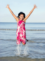 Girl jumping from the sea