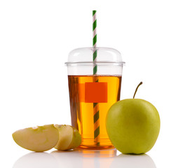 Juice in fast food closed cup with tube and apples isolated