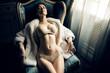 Leinwanddruck Bild - Sexy girl in a chair