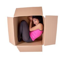 girl sleeping in a cardboard box