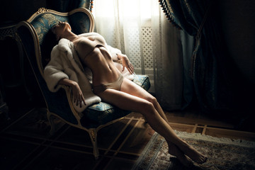 Sexy girl in a chair
