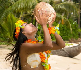 woman drinking coconut milk