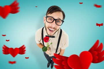 Composite image of geeky lovesick hipster holding rose