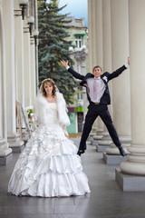 Fun groom and bride in autumn wedding day
