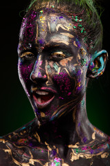 brunette with glowing disco makeup. Black face and neon face art