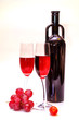 original red vine bottle, red grapes and two wine glasses