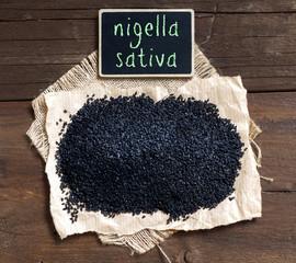 Nigella sativa or Black cumin with small chalkboard