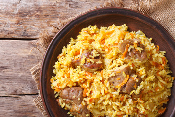 Rice with meat and vegetables closeup. horizontal top view