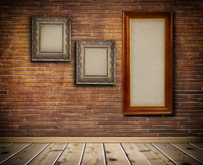 Wooden frames on a bricks wall.