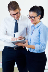 Business people working in the office with digital tablet.