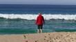 Happy Woman Waiting Big Waves on Beach