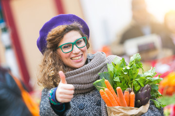 Young Woman Buying Vegetables at Local Market