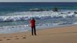 Woman Make Photo Waves in Ocean on Beach