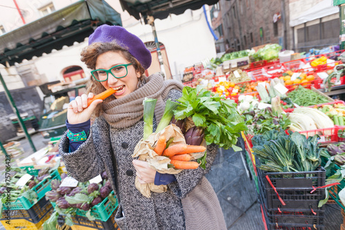 Young Woman Buying Vegetables at Local Market - 75706423
