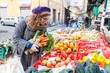 Leinwanddruck Bild - Young Woman Buying Vegetables at Local Market