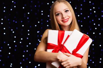 Beautiful teenager girl holding white gift box