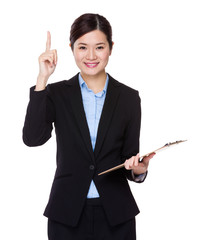 Businesswoman hold with clipboard and finger point up