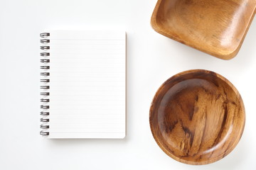 Blank open notebook and kitchen utensils for recipes