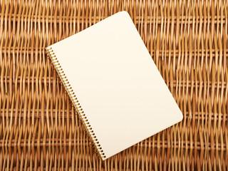 Notebook on  natural basket textures background