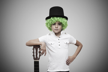 child with green wig on background