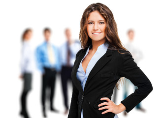 Young woman standing in front of a group of business people