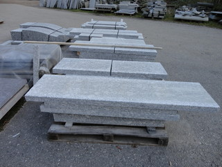 Stacks of granite slabs in a yard