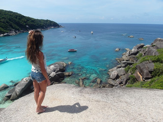 girl on a background of blue sea