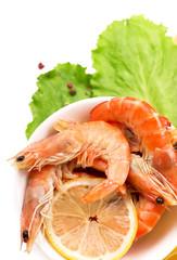 shrimps, lemon and lettuce leaves