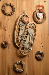 Old Snow Rackets on Wood Wall with Wreaths and Garlands in a Mou