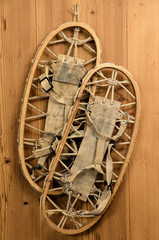 Old Snow Rackets on Wood Wall in a Mountain Cabin