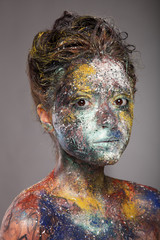 Glitter makeup on a beautiful woman face.