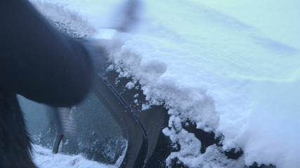 Winter Driving - Woman Removing Snow from a Car