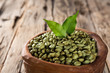 green coffee beans in wooden bowl - 75714020