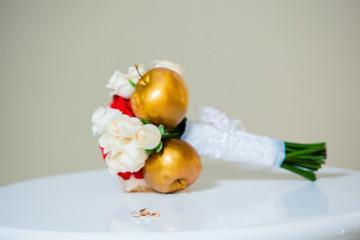 beautiful wedding bouquet of golden apples