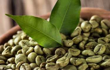 green coffee beans in wooden bowl
