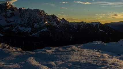 winter last rays of sunshine below Cima Brenta wood cabin