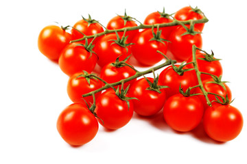 bunnch of cherry tomatoes isolated on a white background