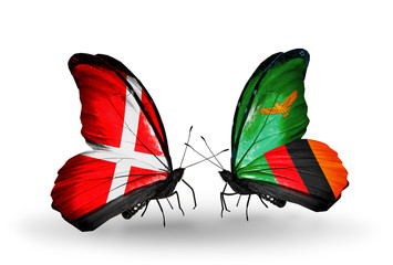 Two butterflies with flags Denmark and Zambia