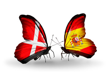 Two butterflies with flags Denmark and  Spain