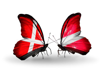Two butterflies with flags Denmark and Latvia
