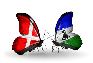 Two butterflies with flags Denmark and Lesotho