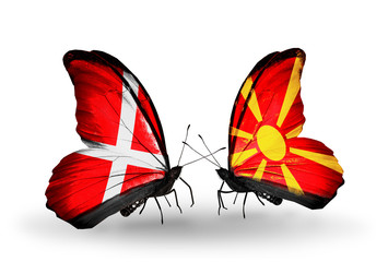 Two butterflies with flags Denmark and  Macedonia