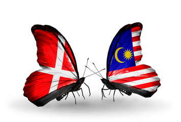 Two butterflies with flags Denmark and  Malaysia