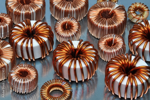 Electric coils on metal background - 75717453