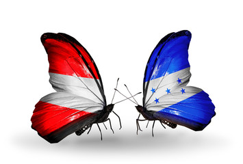Two butterflies with flags Austria and Honduras