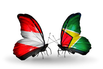 Two butterflies with flags Austria and Guyana