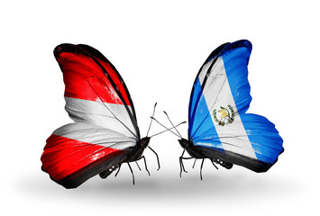 Two butterflies with flags Austria and Guatemala